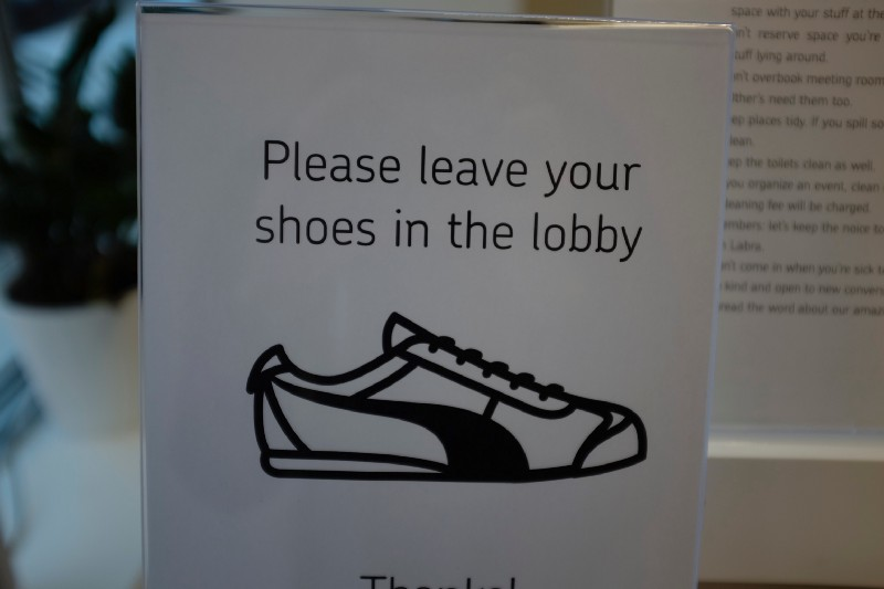 We don't like to wear shoes inside buildings.